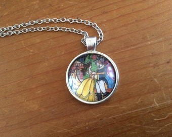 """Beauty and the Beast """"Stained Glass Window"""" - glass fronted circle cabochon in brass and silver. Includes necklace chain"""