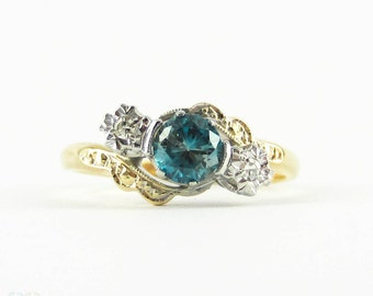 Blue Zircon & Diamond Ring, Three Stone Bypass Style Engagement Ring in Engraved Setting. Circa 1930s, 18ct and Platinum.