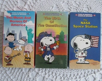 VHS Movie Lot of 3 This is America Charlie Brown The Birth of the Constitution Nasa Space Station Music and Heroes of America Peanuts