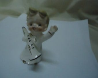 Vintage Young Man Holding Horn or Bugle Instrument Figurine , collectable