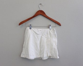 Vintage 80s white Nike Mini Shirt  Medium