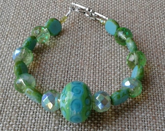 Green and Blue Sparkly Bracelet with Czech Glass and Focal Lampwork Bead, 7.5 inches