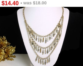 Vintage Bib Necklace with Three Chains of  Goldtone beads stacked with clear Ice Chunk style Cubes