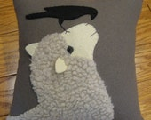 Good Morning Mr. Crow.....  Wool applique sheep pillow