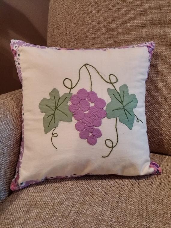 Small decorative pillow from vintage grape applique square