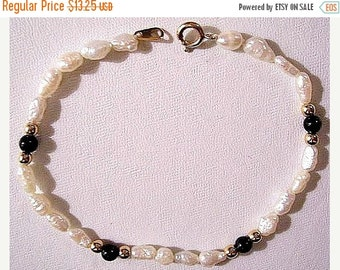 ON SALE White Freshwater Pearl Bracelet Gold Tone Vintage Avon Round Lucite Black Spacers Textured Oval Beads