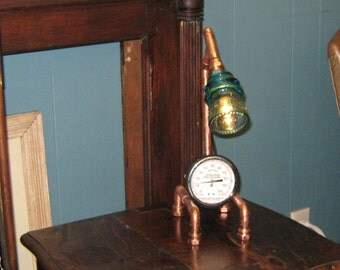 Steampunk , Industrial, desk lamp made with copper an insulator and a thermometer.