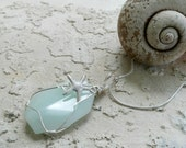 Wire wrapped sea green glass faceted beach pendant with silver starfish and 18 inch sterling chain