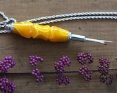 Handturned Acrylic Seam Ripper Necklace in Yellow with White Swirl with Chrome