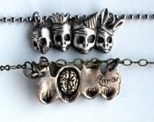 Silver skull necklace, party skulls