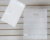 100 White Plastic Merchandise Bags (12 x 15 in.)