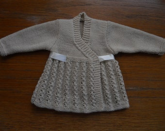 Preemie or small baby cardigan/wrapover/jacket, hand knitted in baby soft beige yarn. Vintage 1940's pattern. Chest 12-16 ins