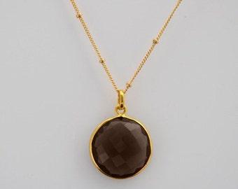 Smoky quartz solatire bezel set gold necklace