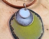 Enameled necklace with warm green and blue grey on leather cord
