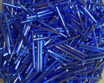 30mm silver lined saphire blue glass bugle beads 20gr
