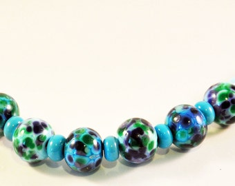 Seag green frit decorated lampwork beads