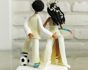 Playful couple with soccer ball and board custom cake topper