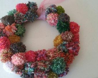 Fun and funky pom pom wreath // baby girl decor // nursery decoration // pink wreath