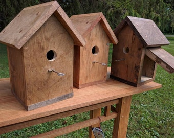 Solid spalted cherry bird houses with skeleton key perch
