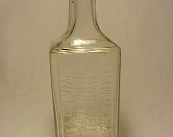 c1890s Cream of Fresh Lemons made by Central Mfg. Co. Iowa City, IA. , Cork Top Clear Blown Glass Skin Cream bottle