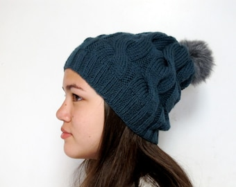 Slouchy cabled grayish green wool beanie with grey pompom