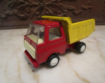 Vintage red and yellow 'JAPAN' dump truck!