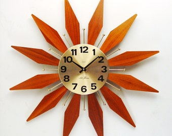 Starburst Clock, Mid Century Sunburst Wall Clock with Atomic design and Teak-faced Rays. Disassembles