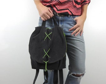 backpack purse with design your own options. fabric choices in chevron, corduroy, suede. suede lace up accent on flap. adjustable straps.
