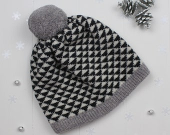 Knitted pom pom hat - made in Great Britain from 100% lambswool in charcoal, grey and cream monochrome geometric triangle design.