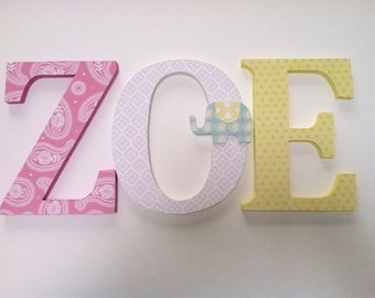 Wooden  letters for nursery in yellow,white and pink