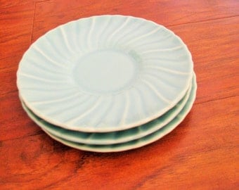 Three Franciscan Coronado aqua swirl saucers