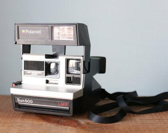 Vintage Polaroid Sun 600 Camera LMS Light Management System Instant Film Tested & Working in Original Box with Manual