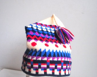 Winter vintage 80s handmade, pure virgin wool, knit hat with a multicolor geometric print and tassel. Made by Murray Merkley.