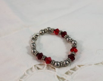 Small Child's or Small Wrist Stretch Red and Silver Bracelet