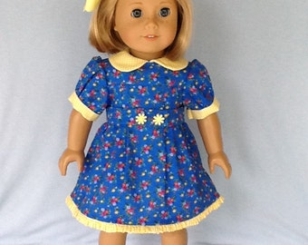 18 inch doll dress and hair clip. Fits American Girl Dolls. Blue calico with yellow gingham contrast