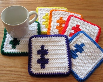 Puzzle Coasters. Set of 6, white crochet coasters with rainbow color puzzle pieces