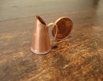 dollhouse miniature. very small copper jug