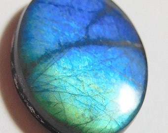 AA  Spectrolite   designer cab  powerful blue and teal buff top oval  10.83 ct. Ylamma cab