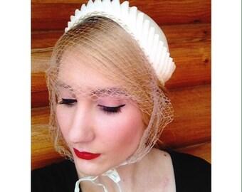 1950s beige vintage classic bonnet netted hat hair