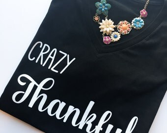Crazy Thankful v-neck graphic shirt. T-shirt for women with signature crazy thankful design.