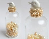 ON HOLD for Héléna.........bird doll, with vintage bottle, packed with vintage faux pearls   from Elizabeth Rosen