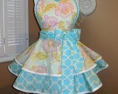 Floral Print Woman's Retro Apron Accented With Aqua, Featuring Heart Shaped Bib