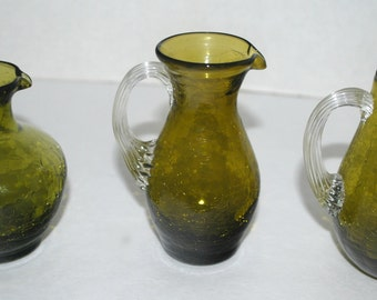 Crackle glass 3 small pitchers glass creamers Olive green vintage glass