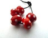 red spotty handmade lampwork glass beads