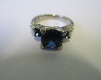 Vintage Claires ring silver toned with blue faceted stone and blue rhinestones ,size aprox 5 1/2  .