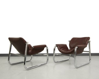 Pair of Mid Century Chrome and Leather Alpha Lounge Chairs by Maurice Burke