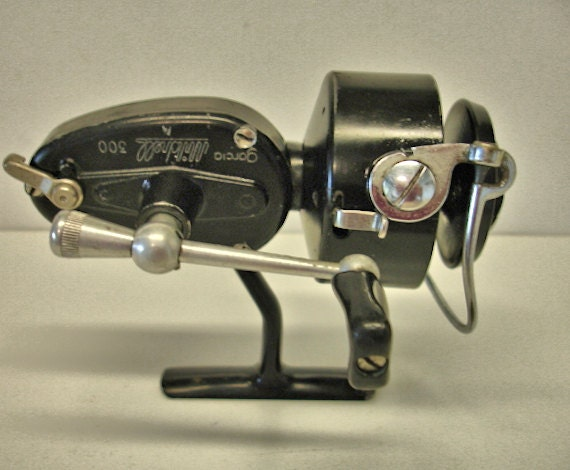Vintage garcia mitchell 300 spinning fishing reel fresh water for Mitchell 300 fishing reel