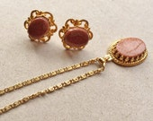 vintage gold stone rhinestone and gold tone metal necklace and matching oval pierced earrings