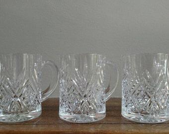 Set of three decorative glass mugs
