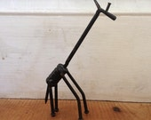 Giraffe figure made from nails, screws and nuts